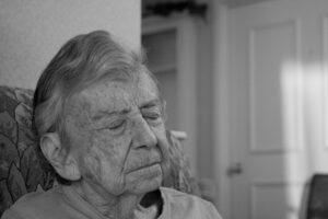 elderly woman eyes closed